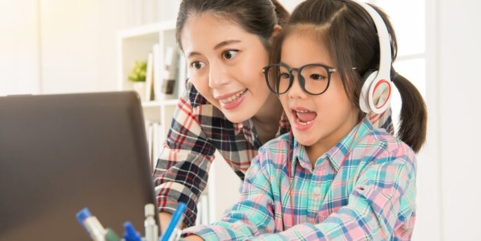 Child and mother looking at internet together