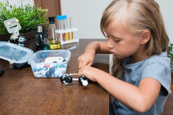 Primary science student building molecule
