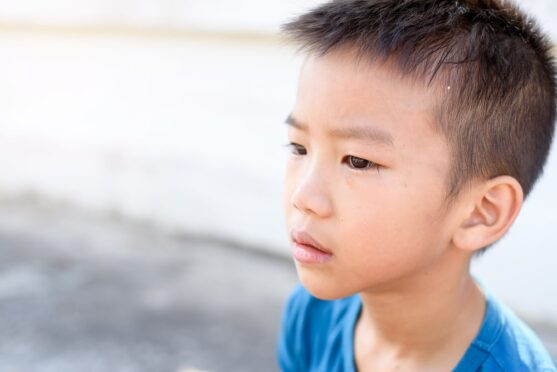boy with school phobia homeschooling in Thailand