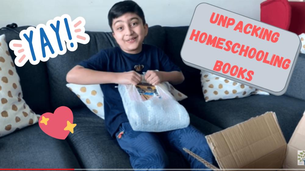 Amaan unpacking his homeschooling books